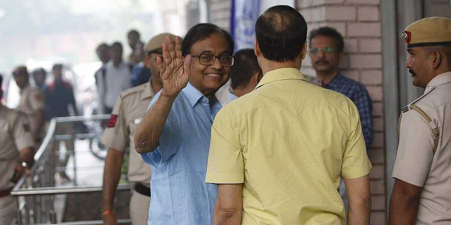 Jailed Congress leader P Chidambaram outside the ED office in New Delhi