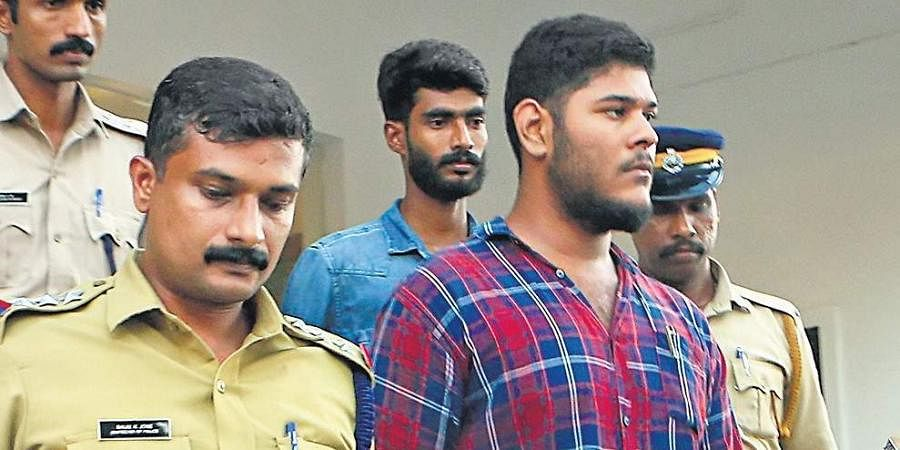 Police bringing Alan Shuhaib and Thwaha Fasal, who were arrested for alleged Maoist links, to the Principal Sessions Court in Kozhikode on Saturday