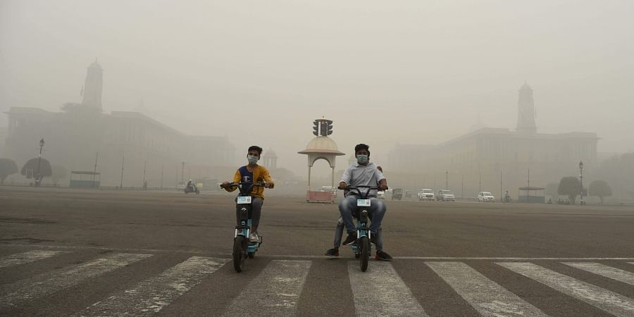 Children wear mask to protect themselves from pollution as a the air quality dips to 'severe' category, in New Delhi