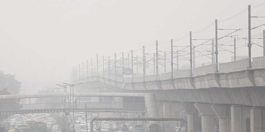Commuter drive-through heavy smog in New Delhi. (Photo | EPS/Arun Kumar)