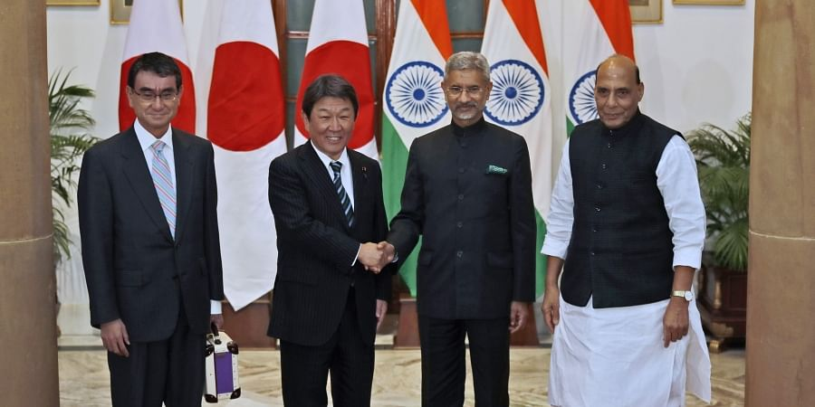 Indian Foreign Minister S. Jaishankar, second right, shakes hand with his Japanese counterpart Toshimitsu Motegi, as Indian Defense Minister Rajnath Singh, right, and Japanese Defense Minister Taro Kono stand beside them before the start of India Japan 2+