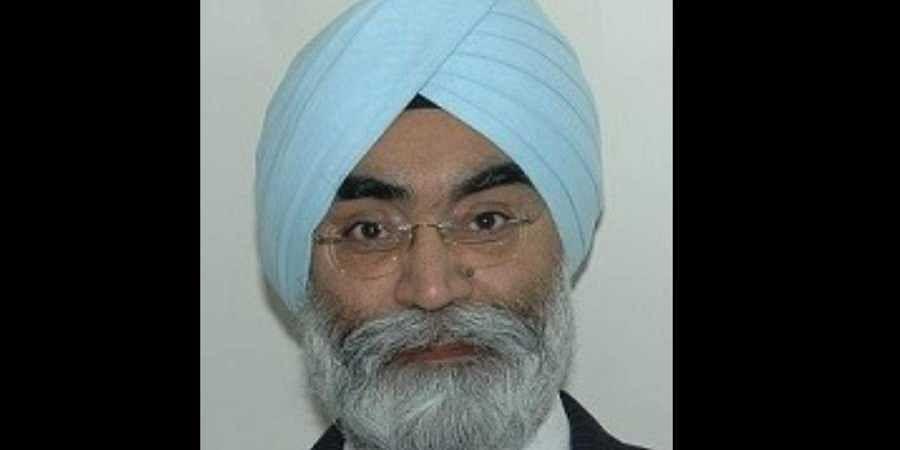 Dr Charan Singh