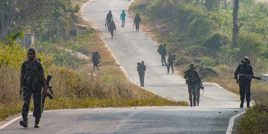 Para-military force personnel conduct searches in the area ahead of Jharkhand Assembly elections in Latehar Friday Nov. 29 2019. (Photo | PTI)