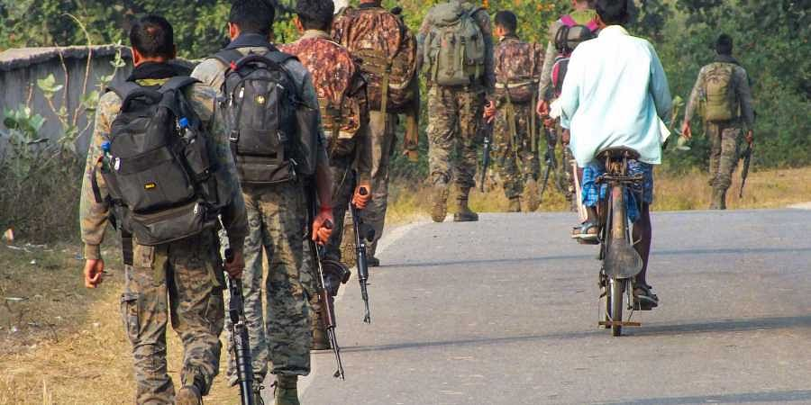Paramilitary force personnel conduct searches in the area ahead of Jharkhand Assembly elections in Latehar Friday Nov. 29 2019. (Photo | PTI)