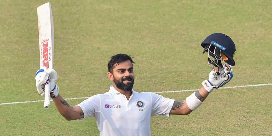 Indian Skipper Virat Kohli acknowledges the crowd after scoring a century. (Photo | PTI)