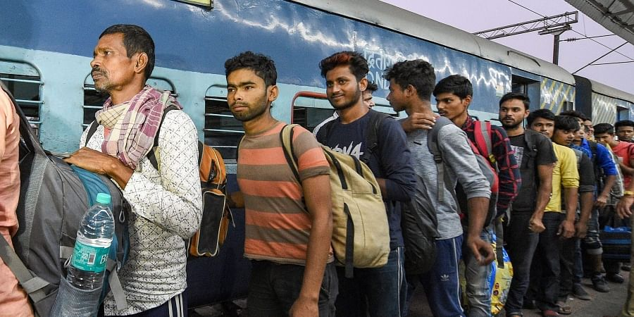 Workers arrive at the station from Jammu and Kashmir in Kolkata Monday Nov. 4 2019. | (Photo | PTI)