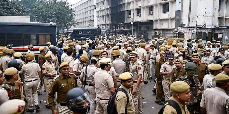 Police personnel at Tis Hazari Court complex after clashes between lawyers and police personnel.