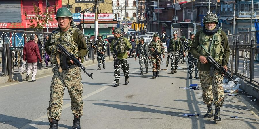 Security personnel sanitising the area after a grenade blast hurled by suspected militants at Hari Singh High Street in Srinagar Monday Nov. 4 2019. | (Photo | PTI)