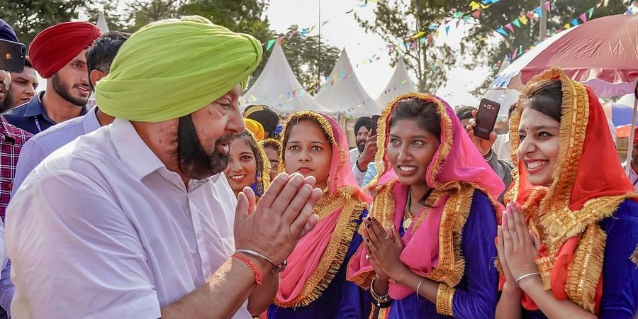 Punjab Chief Minister Captain Amarinder Singh greets as he arrives to perform Sewa voluntary service during the ongoing 550th birth anniversary celebrations of Guru Nanak Dev Ji at Sultanpur Lodhi in Kapurthala district of Punjab Tuesday Nov. 5 2019. | (Photo | PTI)