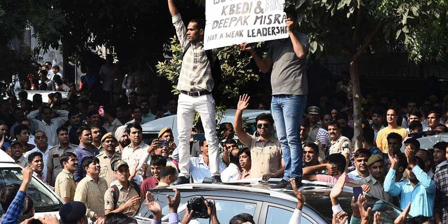 Police personnel gather outside the police headquarters to protest the assault on policemen following clashes with lawyers at Tis Hazari court last week in New Delhi.
