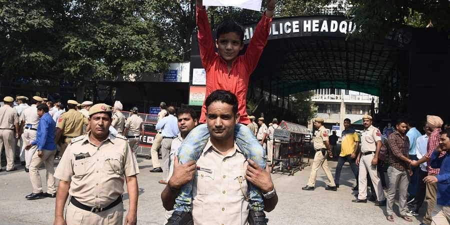 Police officials protest the assault on policemen following clashes with lawyers at Tis Hazari court last week in New Delhi.