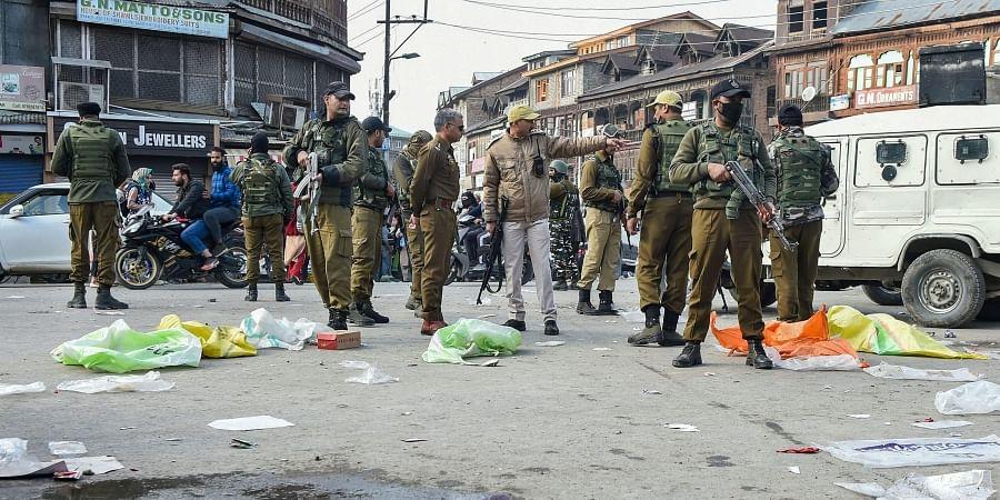Senior security officials inspect the spot of grenade blast hurled by suspected militants at Hari Singh High Street in Srinagar Monday Nov. 4 2019. | (Photo | PTI)
