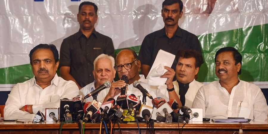 NCP chief Sharad Pawar along with party leaders Jayant Patil and Sunil Tatkare addresses a press conference in Mumbai