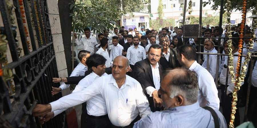 Advocates from the Delhi High Court and all district courts stage a protest inside the Patiala Court