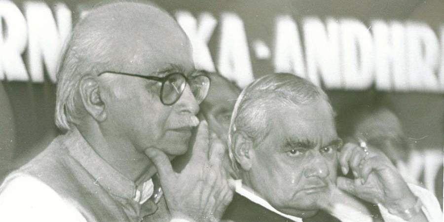 Former PM Atal Bihari Vajpayee with LK Advani at party meeting.