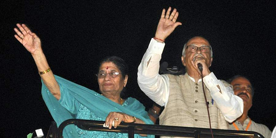 Senior BJP LK Advani along with his wife Kamla Advani wave to the supporters during Jan Chetna Yatra at Ahmedabad in Gujarat.
