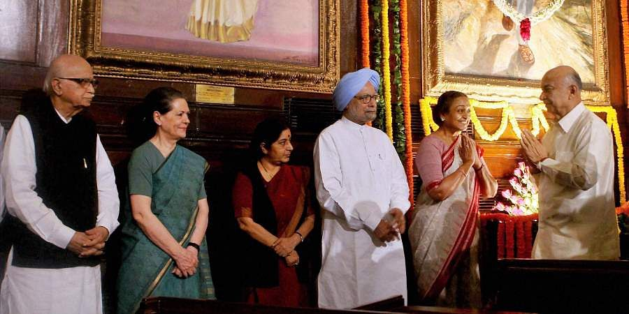 Then PM Manmohan Singh, Lok Sabha Speaker Meira Kumar, Home Minister Sushilkumar Shinde, UPA Chairperson Sonia Gandhi, Senior BJP leader LK Advani and Opposition leader Sushma Swaraj during a function to commemorate 69th birth anniversary of former Prime Minister Rajiv Gandhi in Central Hall of Parliament.