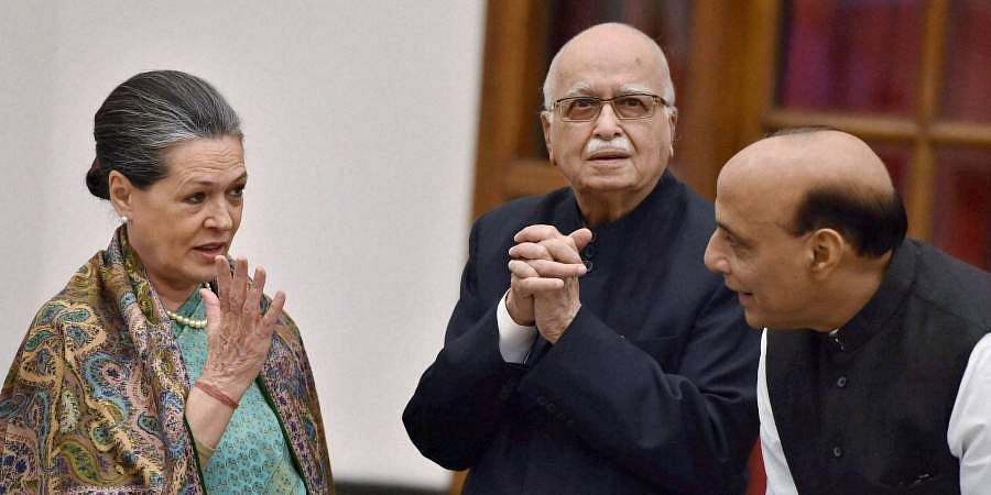 Union Home Minister Rajnath Singh, BJP leader LK Advani and Congress president Sonia Gandhi during a banquet hosted at the Rashtrapati Bhavan in New Delhi.