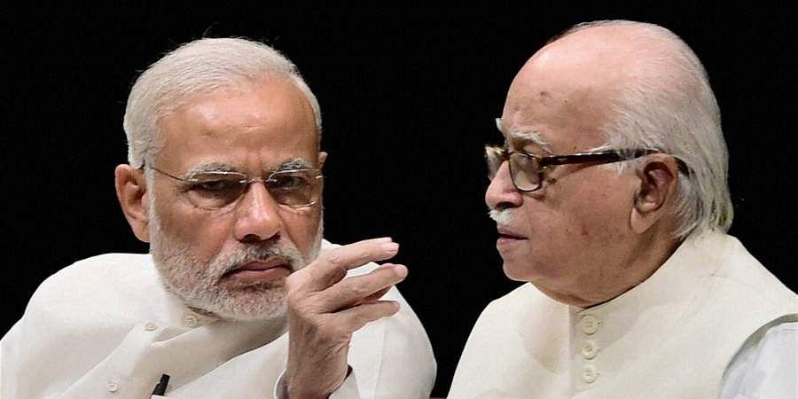 rime Minister Narendra Modi and senior BJP leader LK Advani during the BJP parliamentary board meeting in New Delhi.