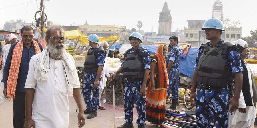 Police personnel stand guard at Naya Ghat in Ayodhya Thursday Nov. 7 2019. | (Photo | PTI)