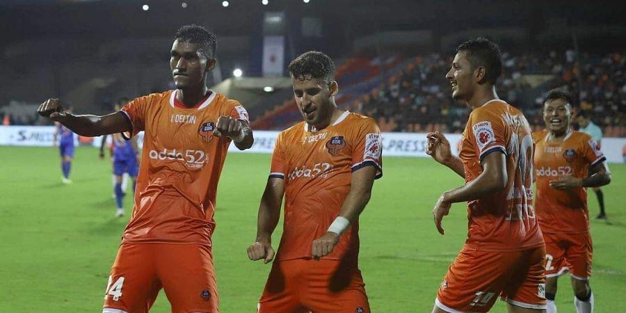 FC Goa players celebrate after scoring a goal.