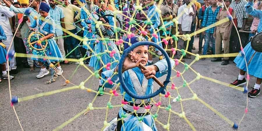 A young boy performing Gatka during the Nagar Keertan in Secunderaba.