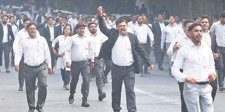 Lawyers shout slogans against the police during a protest outiside Tis Hazari Court.