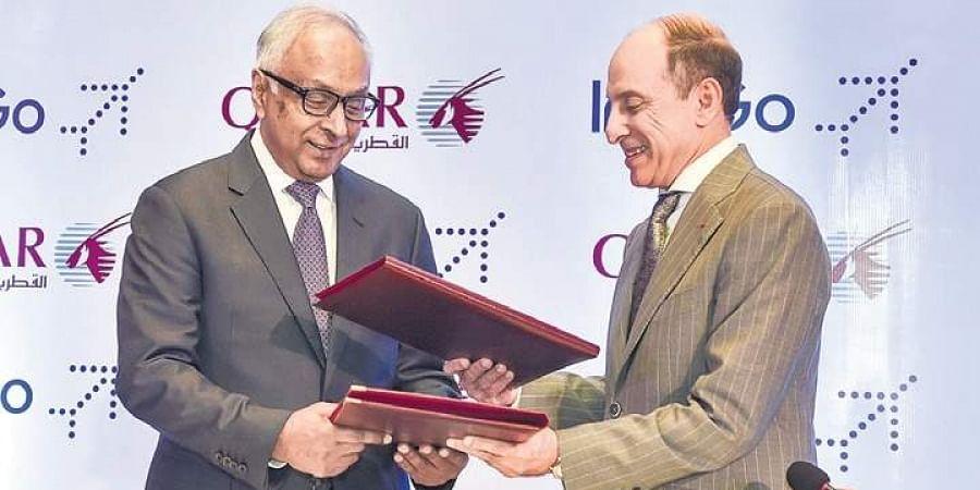 IndiGo CEO Ronojoy Dutta (L) exchanges an MoU with Qatar Airways' CEO Akbar Al Bake for one-way codeshare agreement in New Delhi.