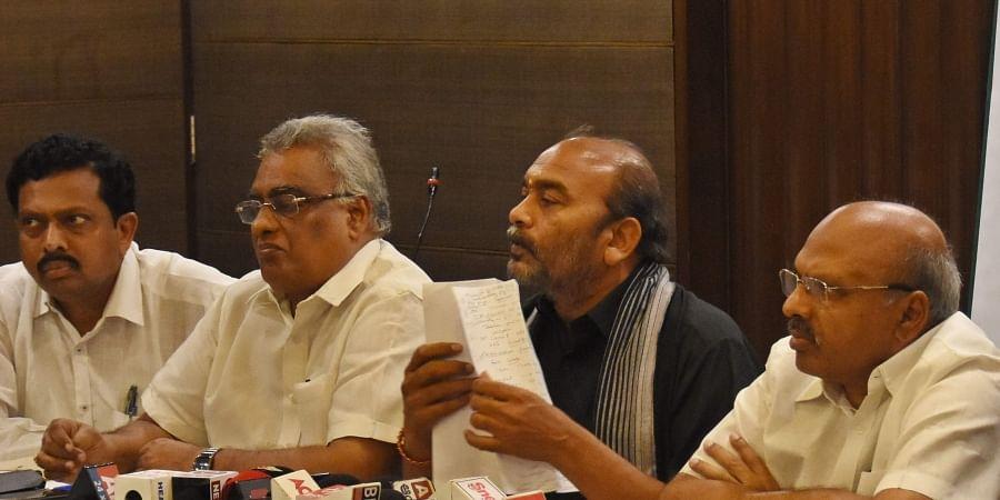 Andhra Pradesh CREDAI members addressing media in Vijayawada on Thursday.