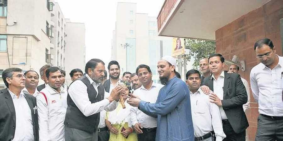 After ugly scenes on Monday, lawyers distribute flowers to the people inside the Saket court complex in New Delhi.