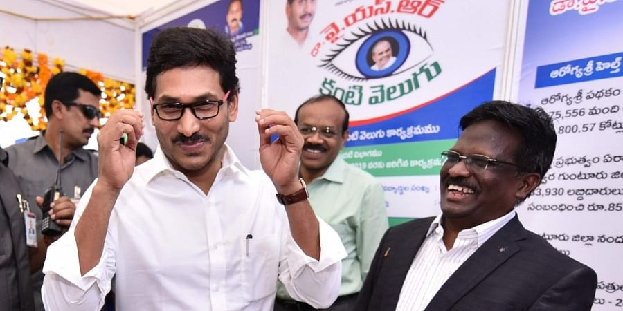 Chief Minister YS Jagan Mohan Reddy tries spectacles to be given under YSR Kanti Velugu at a programme in Guntur on Thursday. (Photo | EPS)