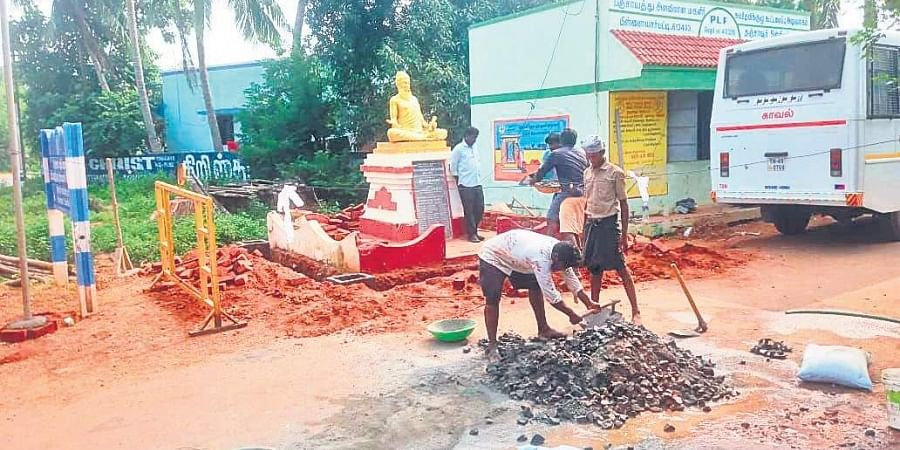 The work of constructing an enclosure for the Tiruvalluvar statue in Vallam  underway on Thursday.   (Photo   EPS)