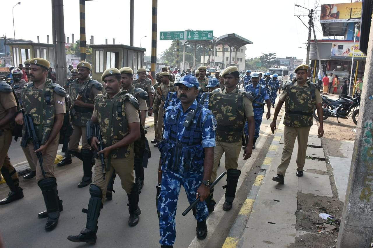 Rapid action force and Tamil Nadu police quick reaction force posted at Athupulam and Karumbukadai junction in Coimbatore City. (Photo | EPS/U Rakesh Kumar)