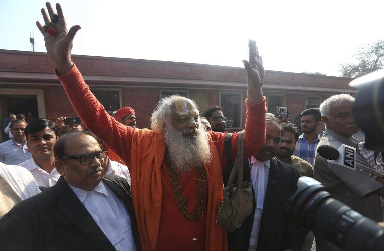 Mahant Dharam Das of the Nirwani Akhara and others arrives at Supreme Court in New Delhi on Saturday. (Photo   EPS/Arun Kumar)