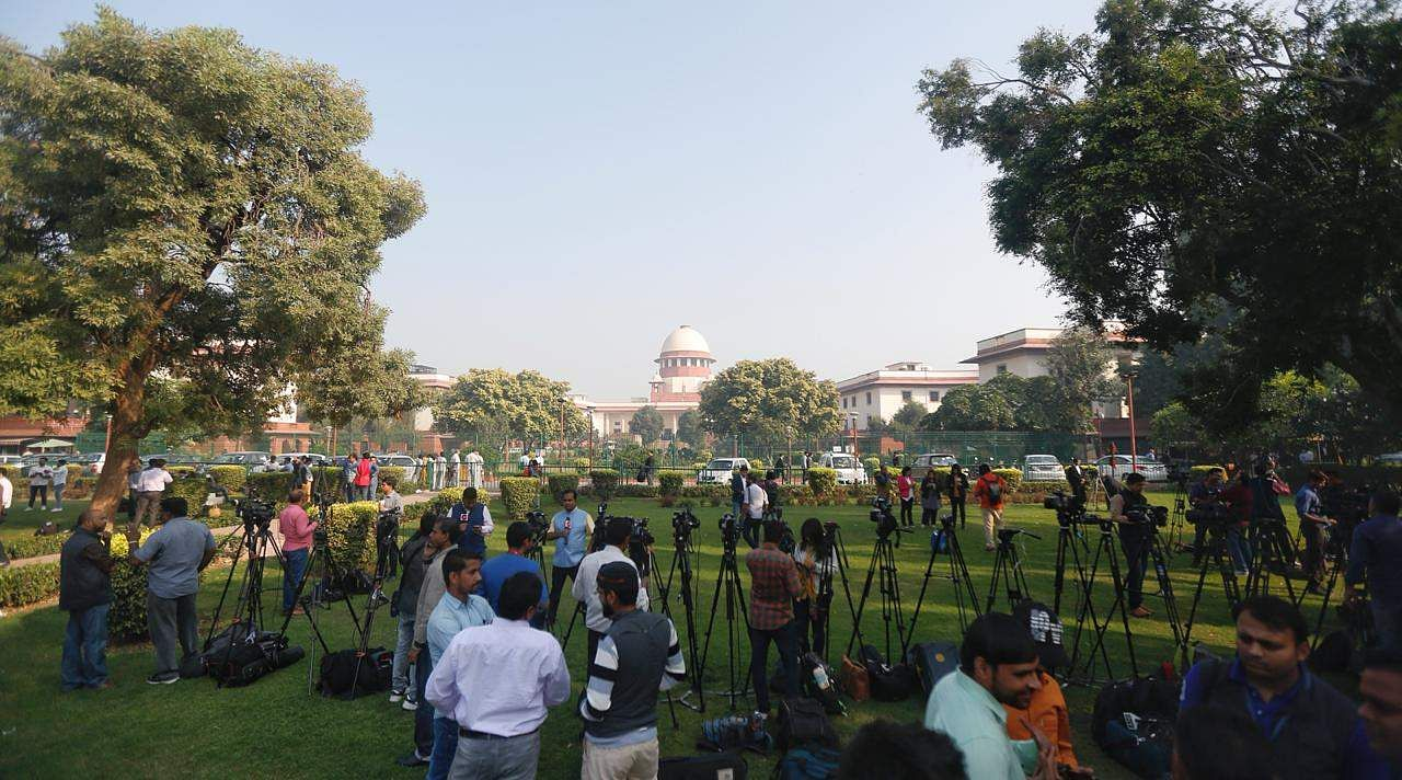 Media Personnel stand at the lawn of the the Supreme court of India on Saturday. (Photo | EPS/Arun Kumar)