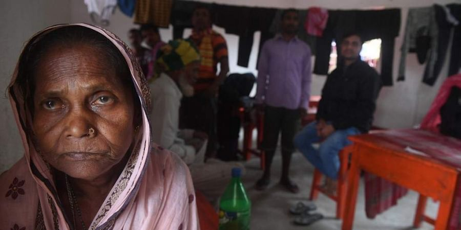 Villagers wait in a shelter after the ferry service to Sagar Island was suspended due to the approaching Cyclone Bulbul in Kakdwip in West Bengal state on November 9, 2019. Cyclone Bulbul, packing a maximum wind speed of 120 kilometres per hour (75 miles), is on course to make landfall near the Sundarbans, the world's largest mangrove forest, which straddles Bangladesh and part of eastern India.