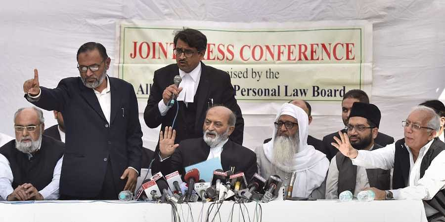 Sunni Central Waqf Board's lawyer Zafaryab Jilani along with other advocates and Muslim leaders addresses a press conference after the Supreme Court pronounces its verdict on Ayodhya land case in New Delhi Saturday.