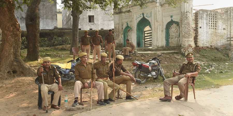 Police personnel guard the premises near the disputed Ram Janambhoomi-Babri Masjid site as the verdict date nears in Ayodhya Friday Nov. 8 2019.