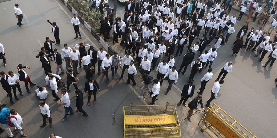 Lawyers shout slogans against Delhi Police during a protest as they block a road outiside Tis Hazari Court in New Delhi on Monday. | (Photo | Arun Kumar/EPS)