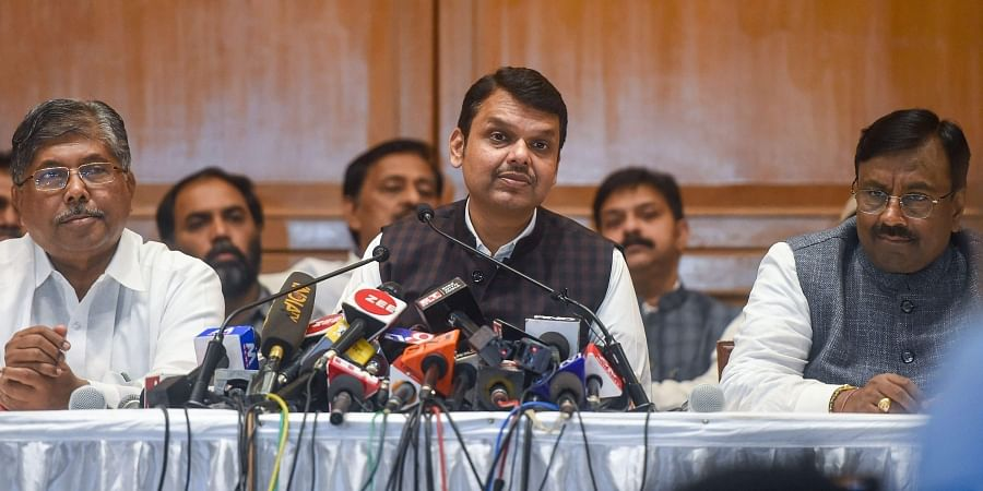 Devendra Fadnavis flanked by senior BJP leader Sudhir Mungantiwar (L) and Maharashtra BJP president Chandrakant Patil (R) interacts with media personnel after his resignation from CM post in Mumbai Friday Nov. 8 2019. | (Photo | PTI)