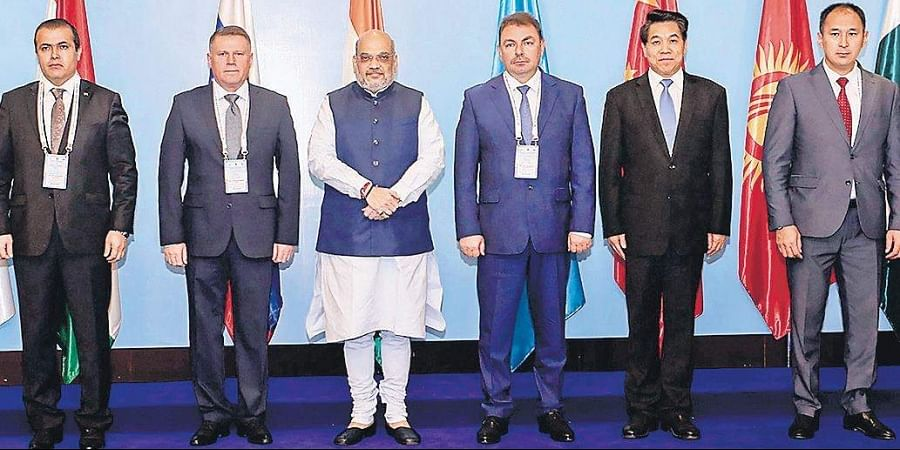 Amit Shah with the HoDs of SCO Member States dealing with disasters. | (Photo | PTI)