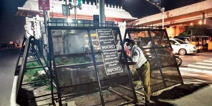 Barricades being erected on Friday on the eve of the  'Chalo Tank Bund' protest in Hyderabad by the TSRTC employees.