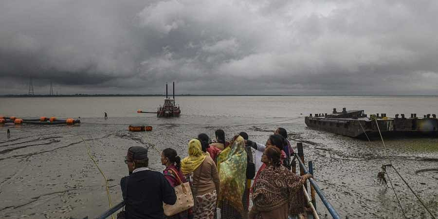 Villagers look into the sea in the wake of the very severe cyclonic storm 'Bulbul' which is likely to make landfall between West Bengal-Bangladesh coasts by late November 9 evening or night