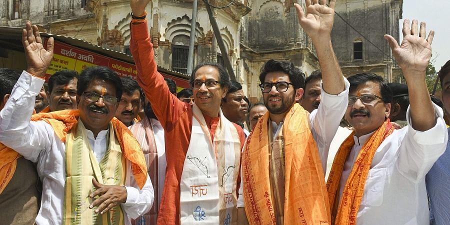 Shiv Sena chief Uddhav Thackeray (L), Yuva Sena chief Aaditya Thackeray and senior party leader Sanjay Raut (R). | (File | PTI)
