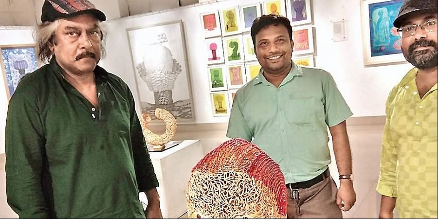 Sudipta Majumdar (centre) with his installantion and Santanu Chakraborty (right) with a visitor to the show