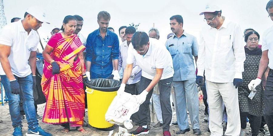 Union Minister of State for shipping Mansukh Mandaviya along with foreign delegates of BIMSTEC participating in a clean-up drive at RK Beach, Vizag, on Friday. (Photo I EPS, G satyanarayana)