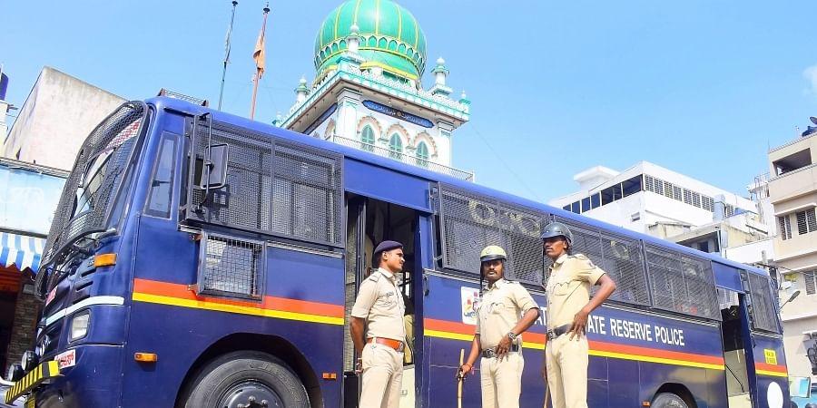 Policemen standing guard at a religious shrine at the shivajinagar in Bengaluru