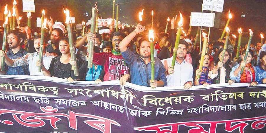 Cotton University students participate in a rally to protest the Citizenship Amendment Bill, in Guwahati