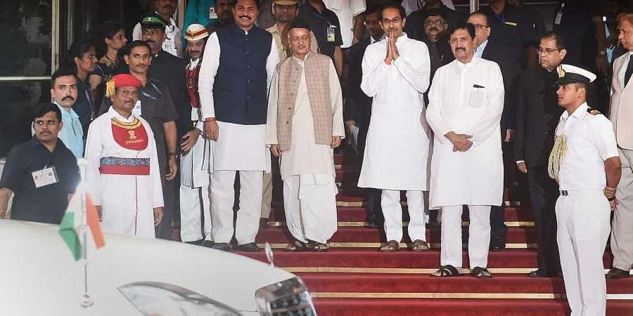 Maharashtra Chief Minister Uddhav Thackeray and State Assembly Speaker Nana Patole with Maharashtra Governor Bhagat Singh Koshyari at Vidhan Bhavan for State Assembly session in Mumbai Sunday Dec. 1 2019. (Photo | PTI)