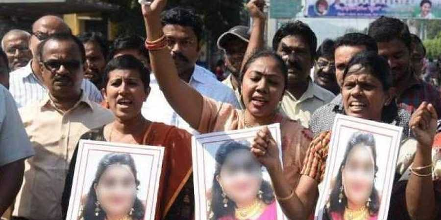Staff members of veterinary hospital in Vijayawada paying tributes to the murdered Hyderabad doctor.